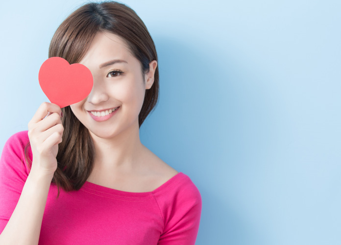 asian woman with pink heart