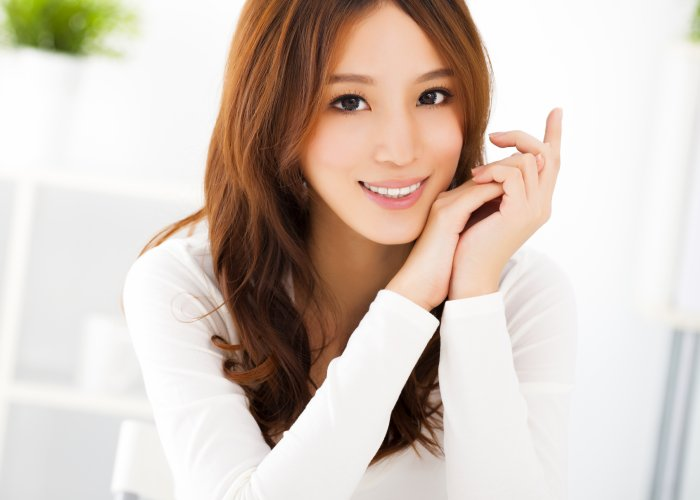 asian woman in white blouse